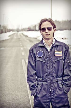 portrait of young student pilot outside the airport,vertical, creative color