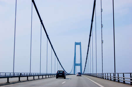 Suspension bridge in Denmark with cars driving, scandinavia