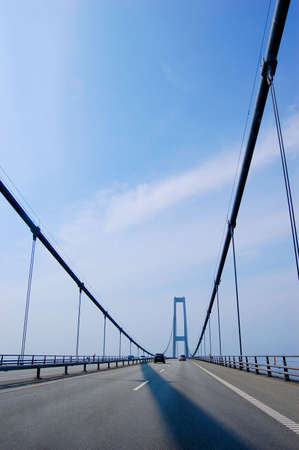 Suspension bridge in Denmark with cars driving, scandinavia, vertical Stock Photo