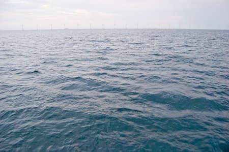 Line of windmill turbines in the open sea in Denmark, Scandinavia photo
