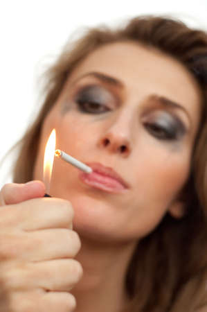 cigarette lighter: portrait of young beautiful woman with leaking makeup, lighter and cigarette on white, isolated, copyspace