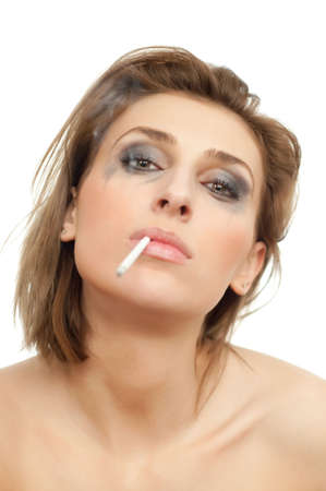 portrait of young beautiful crying woman with leaking makeup and cigarette in her mouth on white, isolated, copyspace, vertical photo