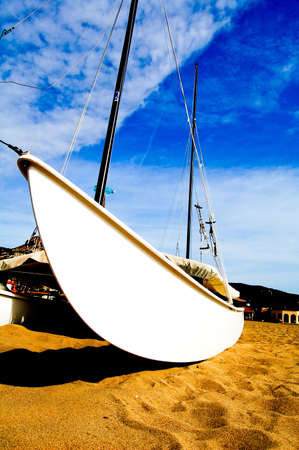 Boats are resting on sand on Sardinia
