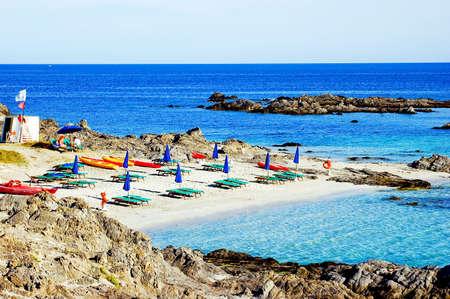Body chairs on a beach in Sardinia