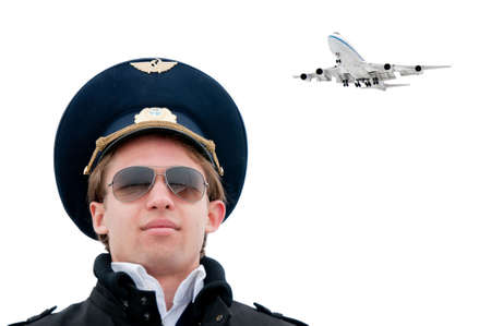 young pilot in glasses isolated with copyspace and plane on background, close photo