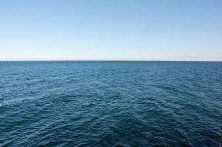 Windmill turbines in a row in the open sea, oresund, denmark