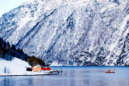 Houses by a lake in a norwegian mountain area in winter