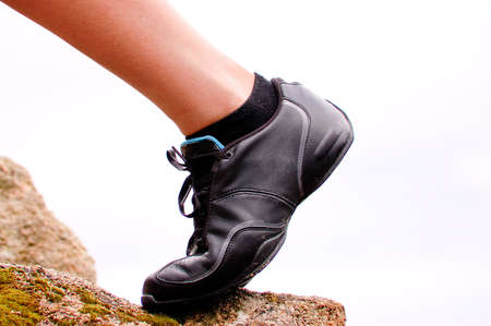 Leg with trekking shoe on