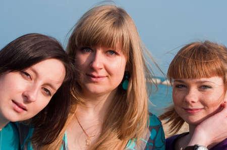 Portrait of three attraktive girls at the beach