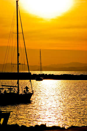 Sailboat at sunset on Sardinia