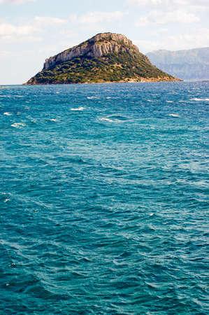 View over beautiful blue lagoon to Mount on Sardinia Stock Photo