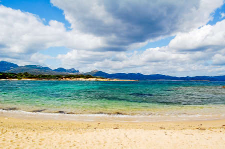 mounts: View over beautiful blue lagoon to Mounts on Sardinia
