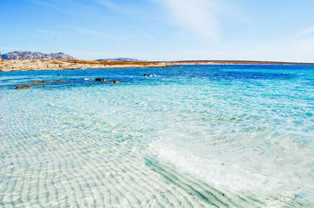 View over beautiful blue lagoon to Mounts on Sardinia