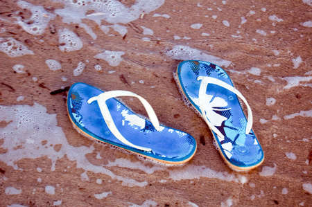 Summer shoes on the sand Stock Photo