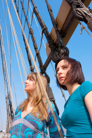Portrait of two girls posing  on a sailboat
