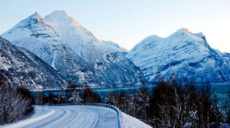 Landscape with winter road and mountains in Norway Stock Photo