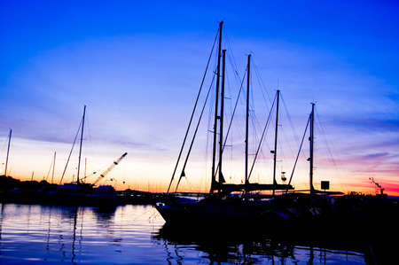 Yachts at blue dusk on Sardinia Stock Photo