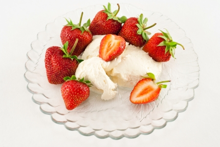 Strawberries and cream isolated on the white background photo