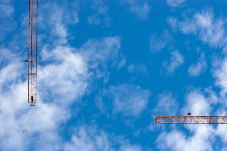 blu sky: Building crane on the backgroung of blu sky Stock Photo