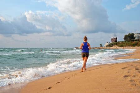 bulgaria girl: The girl running on a sandy beach, Varna, Bulgaria Stock Photo