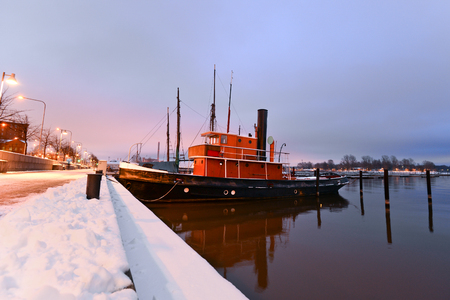 Boats moored in Helsinki in the winter photo