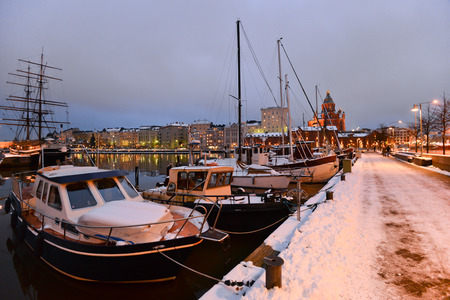 Boats moored in Helsinki during the winter photo