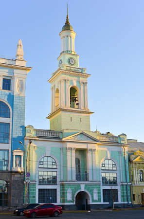 reengineering: Old blue bell tower at the center of Kiev and tender blue sky, Ukraine