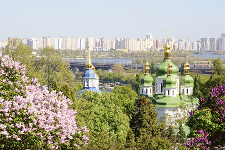 Beautiful spring landscape of Kiev city overlooking the Dnieper River and botanical garden with blooming lilac