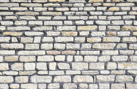 Beautiful modern funky loft wall background. Gray pattern of style design decorative real stone wall surface. Part of stone wall for background or texture. Stonewall architectural background
