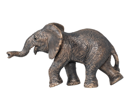 Toy elephant isolated on white background. Plastic toy elephant. Little elephant walking isolated on a white background. The elephant is a symbol of the Republican Party. Stock Photo