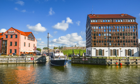 Klaipeda, Lithuania - August 22, 2017: View on modern and old hotels and Curonian Lagoon, city center of Klaipeda, Lithuania. Old town and port of Klaipeda. Old Mill Conference Hotel Klaipeda