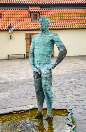 Prague, Czech Republic - October 10, 2017: Sculpture of two pissing men in front of Franz Kafka museum in Prague. Fountain of Pissing Men in Prague by David Cerny, sculptor. Editorial