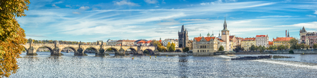Prague, Czech Republic - October 10, 2017: Panoramic autumn river view on the Vltava river, Charles Bridge and Prague Castle, Czech Republic. Prague old town. Panorama. Standard-Bild - 101998868