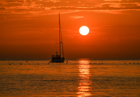 Beautiful evening Adriatic sea, yacht and sunset sky, Croatia. Evening seascape.