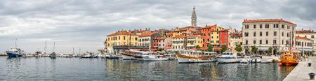 Rovinj, Croatia - May 22, 2018: Coastal town of Rovinj, Istria, Croatia. Rovinj - beautiful antique city, yachts and Adriatic Sea. Panorama. Standard-Bild - 103888397