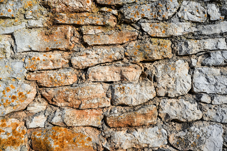 Old grey and yellow stone wall background or texture. Template or mock up. Medieval stone wall Standard-Bild - 109337800