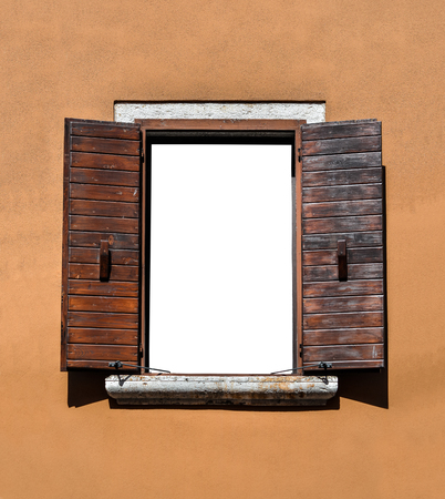 Opened wooden window isolated. Beautiful old window frame with brown wooden shutters and bright terracotta wall. Rural or antique window frame. Design element. Template or mock up. Standard-Bild - 109337803
