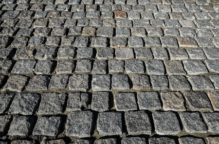 Stone road close up. Old pavement of granite. Grey square cobblestone sidewalk. Mock up or vintage grunge texture. Standard-Bild - 109542004