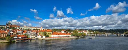 Prague, Czech Republic - October 10, 2017: Bright and beautiful autumn view on Vltava river, Saint Vitus Cathedral and Prague Castle, Prague, Czech Republic Standard-Bild - 109529308