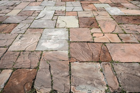 Light brown ancient stone road close up. Old pavement of granite. Brown cobblestone sidewalk. Mock up or vintage grunge texture. Standard-Bild - 110699481