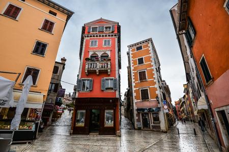 Rovinj, Croatia - May 22, 2018: Coastal town of Rovinj after rain, Istria, Croatia. Rovinj - beautiful antique city, yachts and Adriatic Sea. Cororful building facades in old town of Rovinj, Croatia Standard-Bild - 110720374