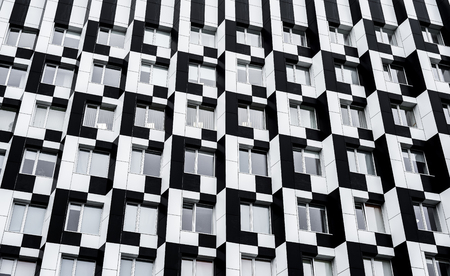 Black and white modern building facade. Perfect for wallpaper, wrapping, fabric, background, template, prints, banners Standard-Bild - 110699300
