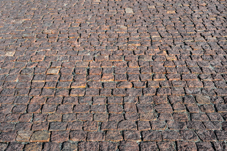 Prospective view on stone road close up. Old pavement of granite. Brown square cobblestone sidewalk. Mock up or vintage grunge texture Standard-Bild - 110801153