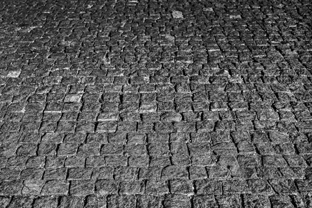 Stone road close up. Old pavement of granite. Grey square cobblestone sidewalk. Mock up or vintage grunge texture. Standard-Bild - 110801155