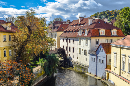 Prague, Czech Republic - October 10, 2017: Certovka river in Prague. Channel between Kampa island and Mala strana. View on the waterwheel at the old mill on the Moldava millstream in Mala Strana Prague, Czech Republic Standard-Bild - 110937546