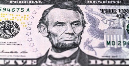 Lincoln's portrait on a $ 5 bill. Fie dollar bill close up. Money background