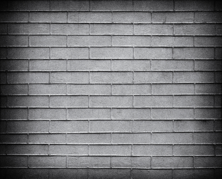 Gray Brick wall with darkened edges . Top view. Modern brick wall wallpaper design for web or graphic art projects. Abstract background for business cards and covers. Template or mock up.