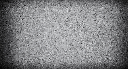 Cement or concrete wall background with darkened edges. Deep focus. Mock up or template. Dark corners Foto de archivo
