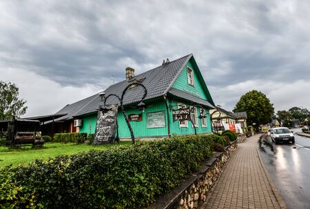 Trakai, Lithuania - August 15, 2017: Beautiful old wooden buildings near Trakai lake. Streets of Trakai town, Lithuania