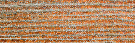 Brick wall, wide panorama of masonry. Wall with small Bricks. Modern wallpaper design for web or graphic art projects. Abstract template or mock up. Фото со стока